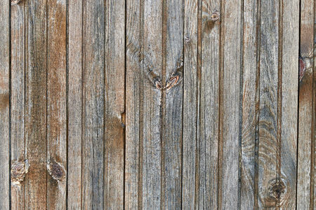 Background texture of the old faded wood close-up.