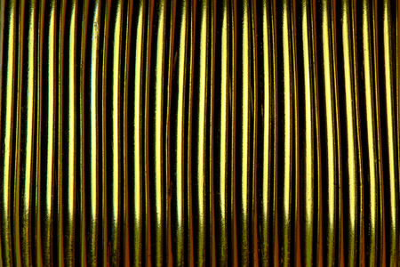 Background texture of gold rope close-up.