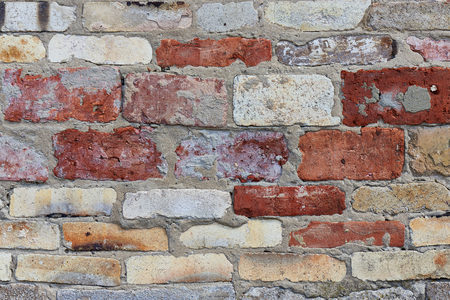Background texture of multi-colored brick wall.