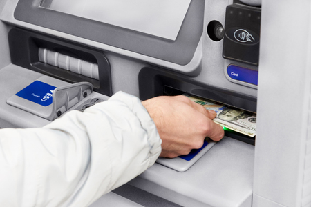 Cash withdrawal in dollars from an ATM.