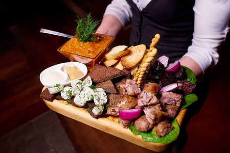 Traditional sausage, toasts, lard and sauce on a wooden tray. Stock fotó