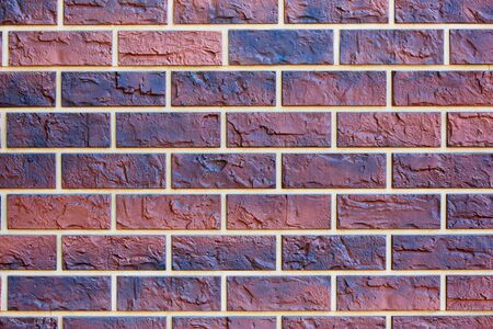Background texture of colored brick wall.