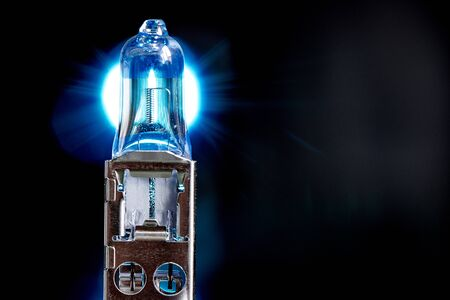 Spare light bulb for a cars headlights on black background.Ð¡opy space.