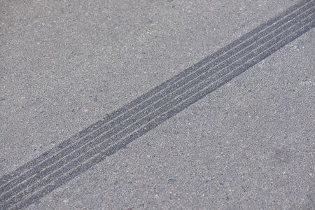 The track on the road from sudden braking.