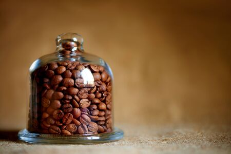 Coffee beans under the glass dome. Copy space. Stock fotó