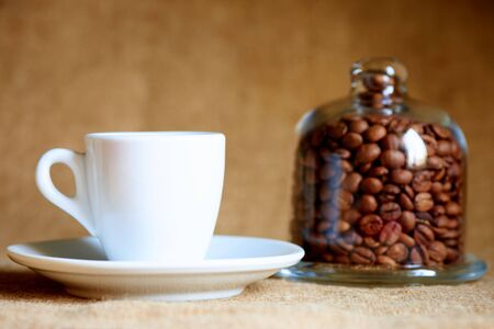 White cup with coffee on a blurred background. Stock fotó