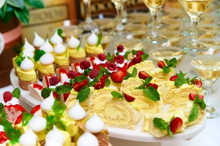 Buffet table with various cakes.Catering.