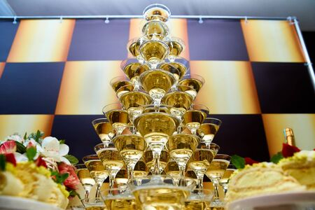 Pyramid of champagne at event, party or banquet.