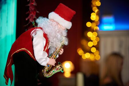Decorative Santa Claus with a saxophone.