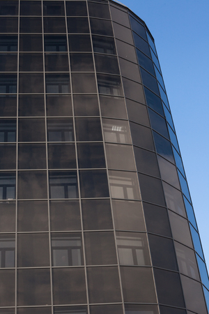futurism: Office building against the sky in the city Stock Photo