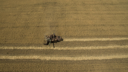 machinery: Tractor in the field view from above