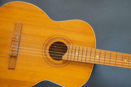 wooden brown guitar on a dark background