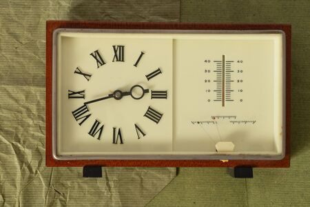 soviet table clock in a wooden frame lie on the table