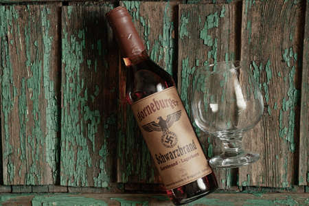 Ukraine, Dnipro - April 06, 2020. horneburger 1939 whiskey of the third reich found in the cellar lies on the table