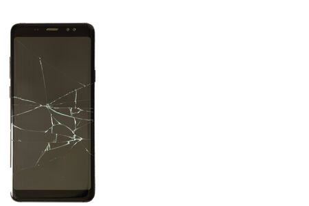 black phone with cracked screen on an isolated background