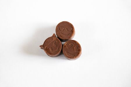 homemade chocolate smiles in the form of smiles on an isolated background
