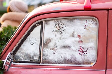 snowflake on the glass of an old car, new year holiday