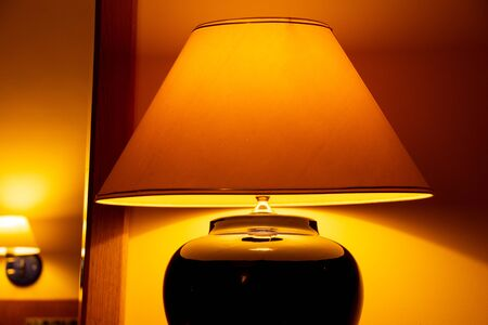 Bedside table lamp light in the room