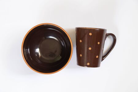 set of identical cups and a plate on an isolated background