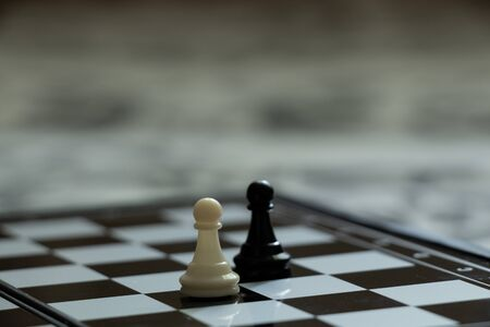 chess pieces on the board in the room during