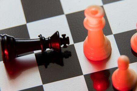 chess pieces on a chessboard in the dark