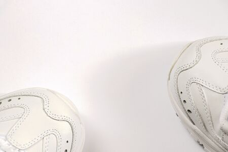 white women s new sneakers on a white background