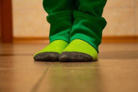 bottom of tiled four-year-old boy at home in socks