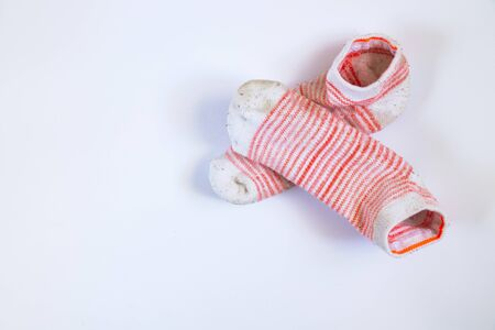 dirty white striped women's socks on a white background