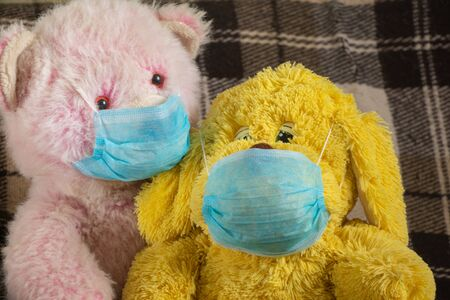 baby teddy bear masked medical closeup epidemic