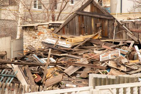 old ruined house covered with boards in Ukraine