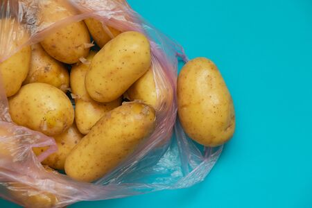 a young potato in a bag on a table bought at a bazaar