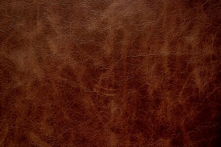 dark brown genuine leather as a close up background,