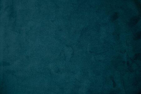 plain dark blue fabric as background close up