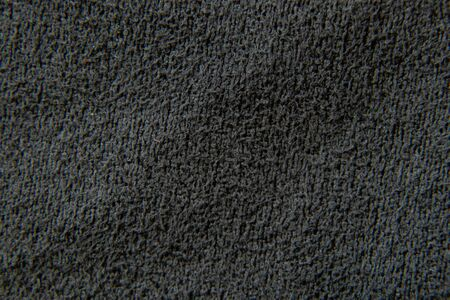 dark gray terry plain fabric as background macro Archivio Fotografico