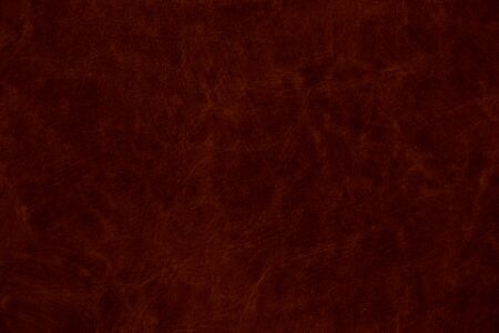 dark red genuine leather as a close up background