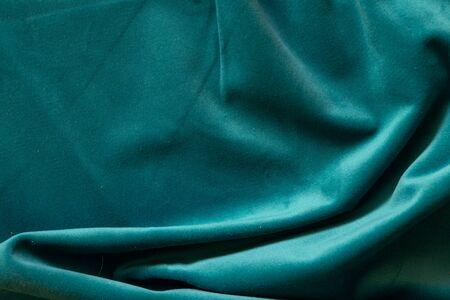 plain dark blue crumpled fabric as a background close up