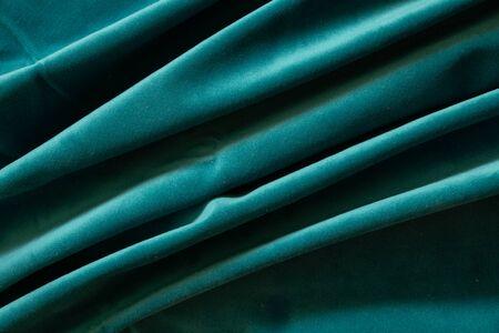 plain dark blue crumpled fabric as a background close up Reklamní fotografie
