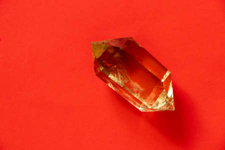 semiprecious citrine crystal on an isolated background