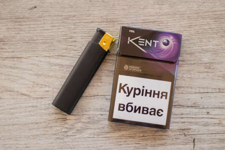 Ukraine, Dnipro - July 02, 2020.a pack of kent cigarettes and a lighter on the table, smoking addiction