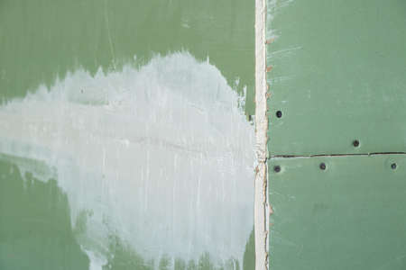 plasterboard green on the wall, room repair