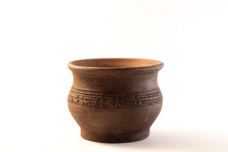 brown clay cup on a white background close up