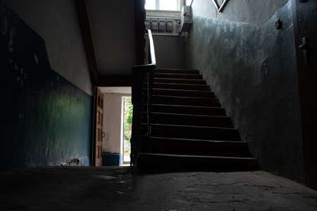 dark staircase inside with a staircase to the second floor in an old house in Ukraine in the cities