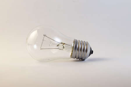 old incandescent bulb lies on a white background 版權商用圖片