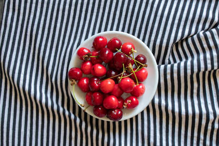 ripe red cherries on a striped background Stock fotó