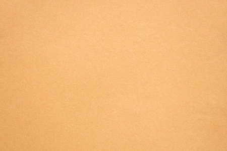 brown paper as background, sheet of paper close-up