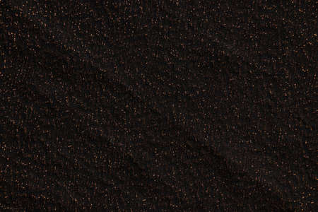 black crumpled fabric with shiny splashes