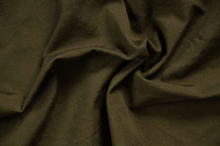 dark green crumpled fabric as background, fabric