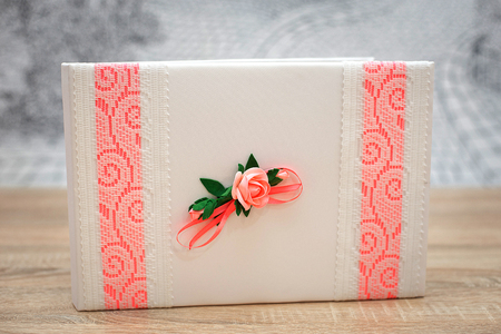 Wedding wish book decorated with flowers and pink lace