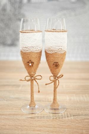 Wedding glasses decorated with cord, beautiful decorated wedding glasses, flowers on wedding glasses, handmade wedding glasses