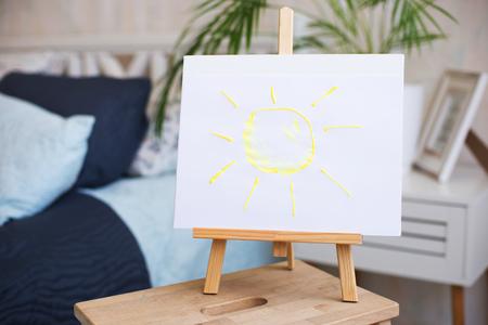 de zon geschilderd op een ezel